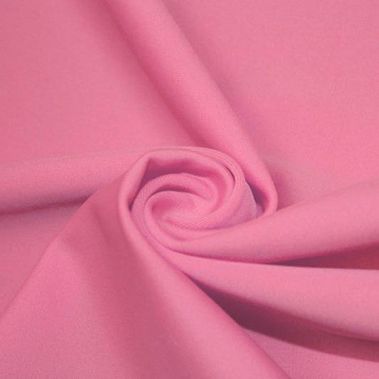 A swirled piece of matte nylon spandex fabric in the color pink sorbet.