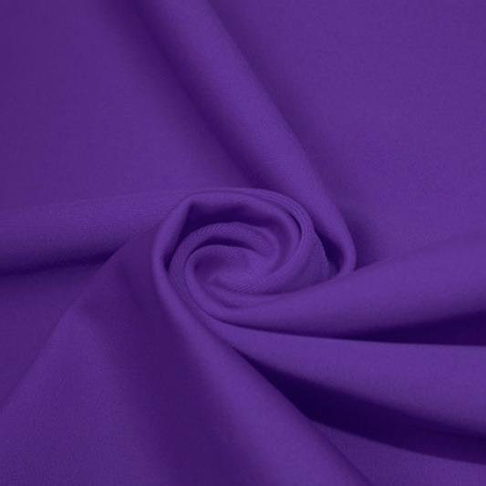 A swirled piece of matte nylon spandex fabric in the color purple.