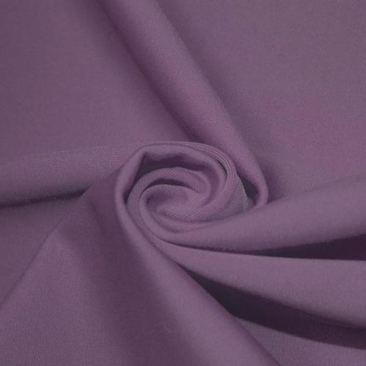 A swirled piece of matte nylon spandex fabric in the color purple haze.