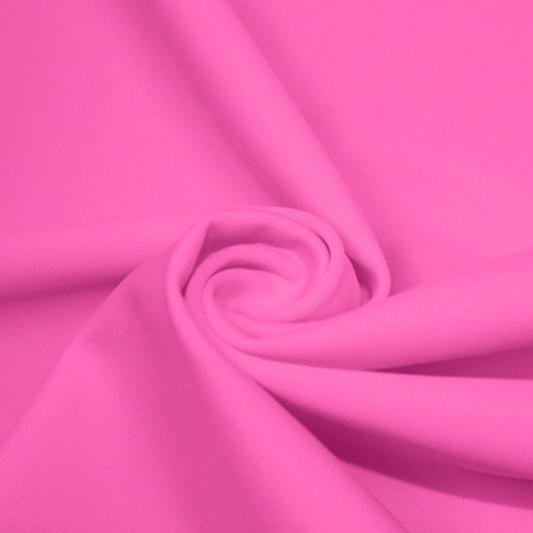 A swirled piece of matte nylon spandex fabric in the color rig pink.