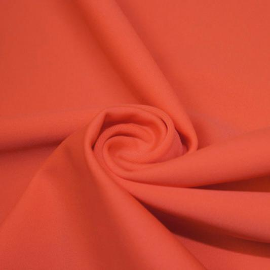 A swirled piece of matte nylon spandex fabric in the color rose.