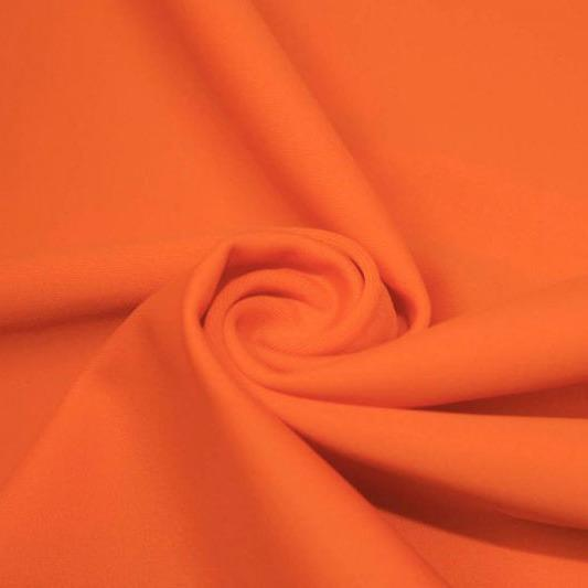 A swirled piece of matte nylon spandex fabric in the color rust.