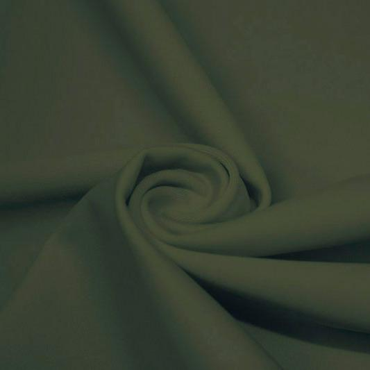 A swirled piece of matte nylon spandex fabric in the color sage.