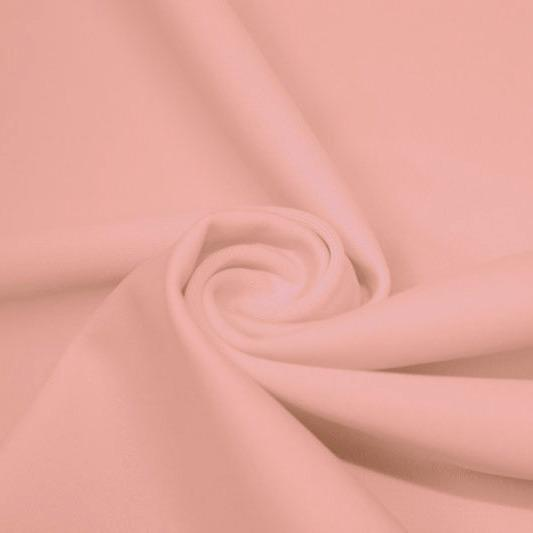 A swirled piece of matte nylon spandex fabric in the color salmon.