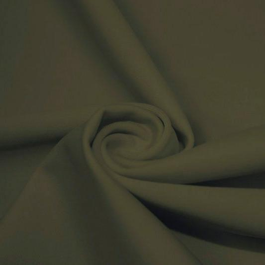 A swirled piece of matte nylon spandex fabric in the color sepia.
