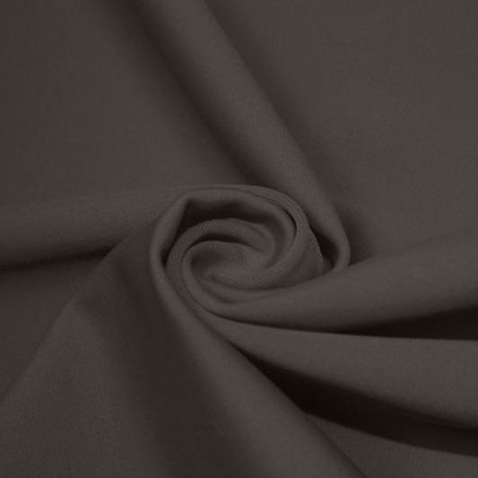A swirled piece of matte nylon spandex fabric in the color slate gray.