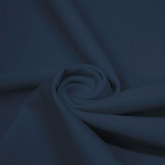 A swirled piece of matte nylon spandex fabric in the color steel blue.
