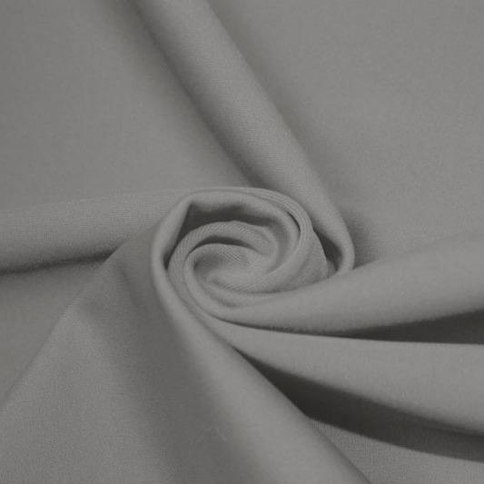 A swirled piece of matte nylon spandex fabric in the color stone.