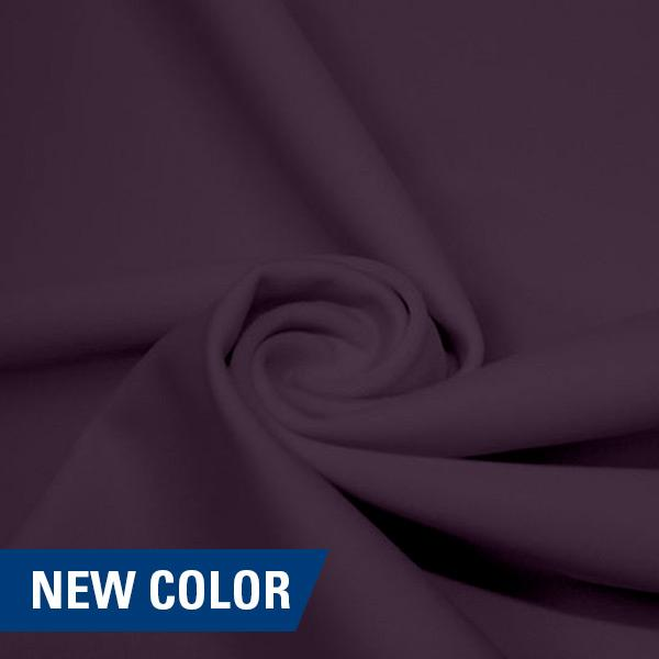A swirled piece of matte nylon spandex fabric in the color toasted mauve.