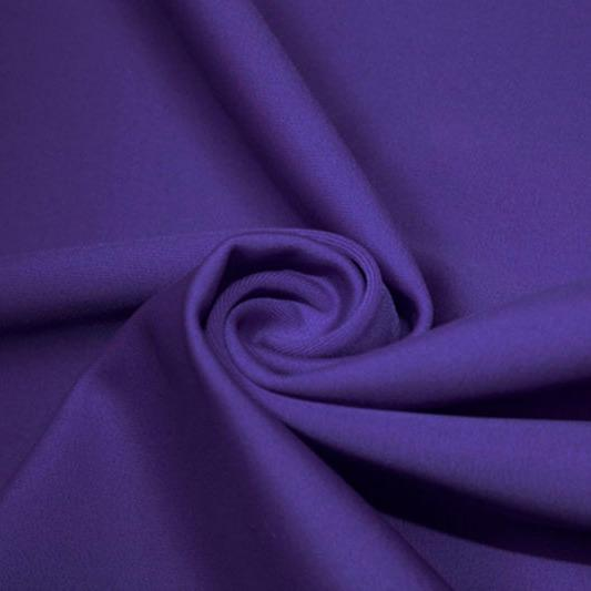 A swirled piece of matte nylon spandex fabric in the color violet.