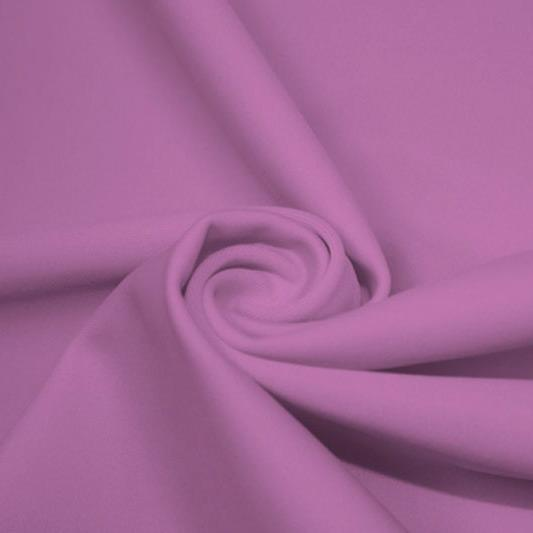 A swirled piece of matte nylon spandex fabric in the color wild orchid.