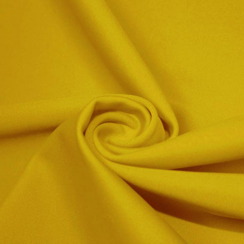 A swirled piece of microfiber nylon spandex in halei yellow.