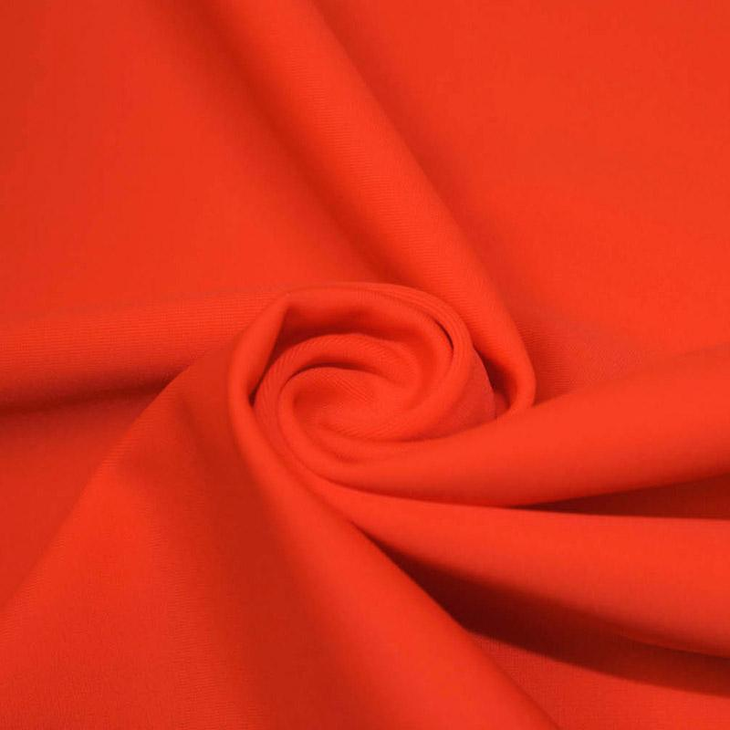 A swirled piece of microfiber nylon spandex in hot coral.
