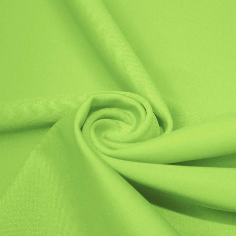 A swirled piece of microfiber nylon spandex in lime.