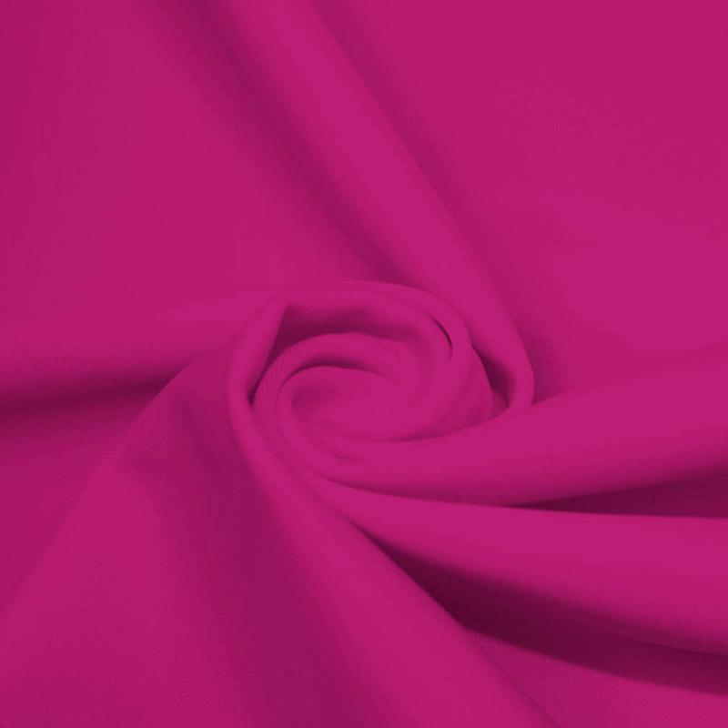 A swirled piece of microfiber nylon spandex in mixed pink.