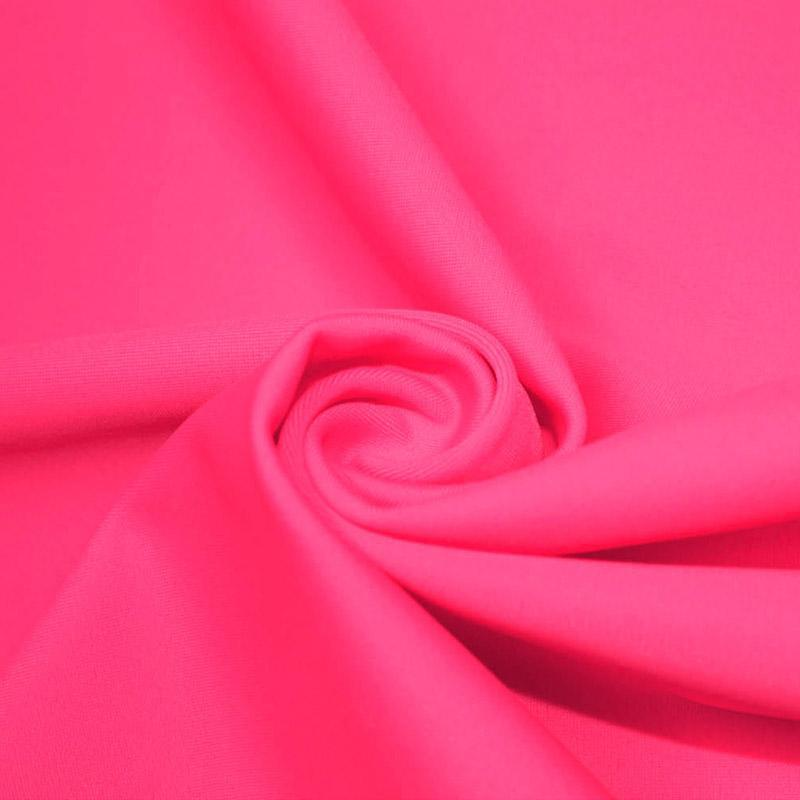 A swirled piece of microfiber nylon spandex in neon pink.