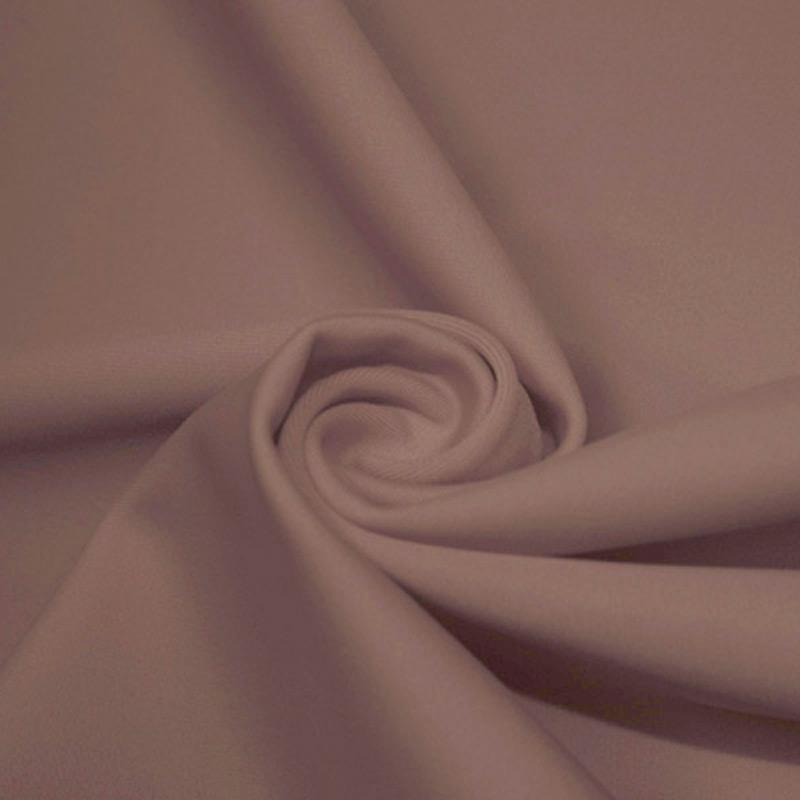 A swirled piece of microfiber nylon spandex in pale iris.