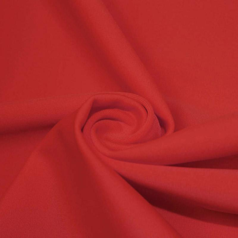A swirled piece of microfiber nylon spandex in red.