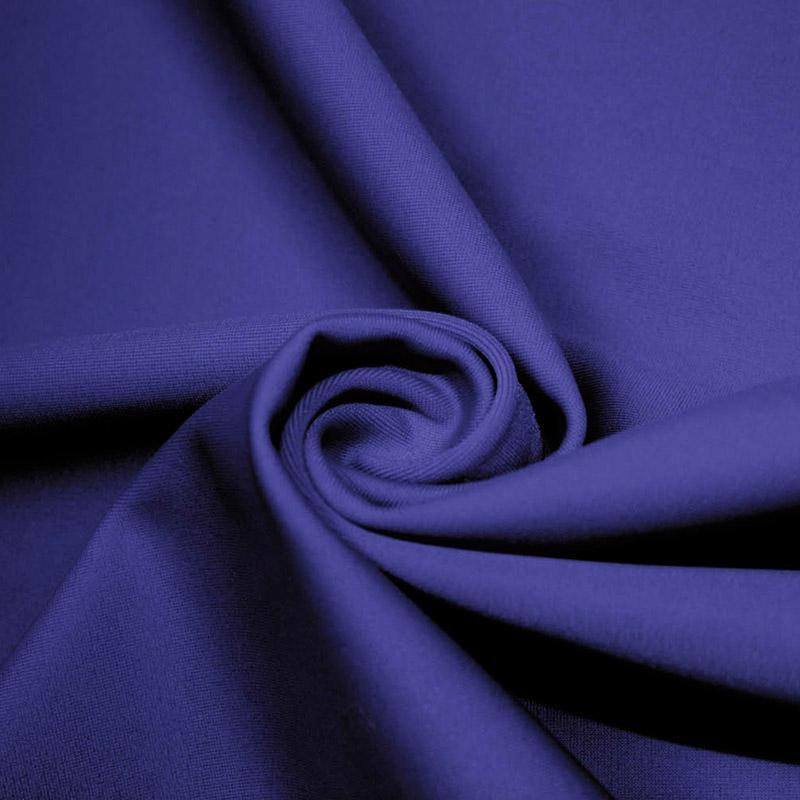 A swirled piece of microfiber nylon spandex in royal.
