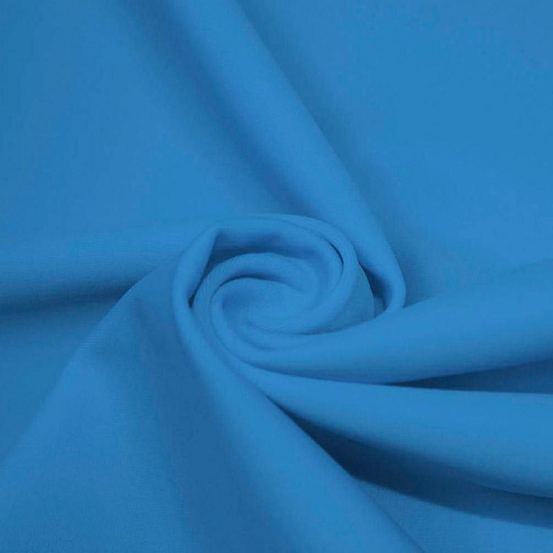 A swirled piece of microfiber nylon spandex in turquoise.
