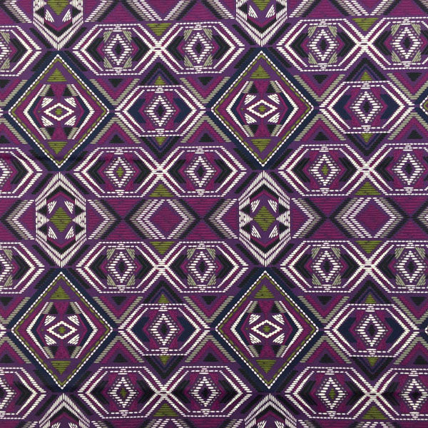 A flat sample of Purple and Green Tribal Printed Spandex.