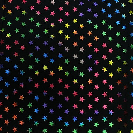 A flat sample of Rainbow Stars on Black Foiled Spandex.