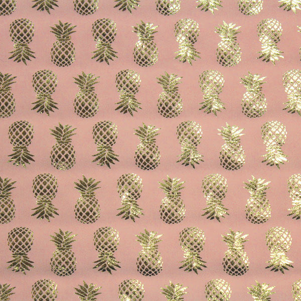 A flat sample of Gold Pineapples on Pink Foiled Spandex.
