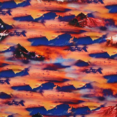 A flat sample of Cloudy Mountain Range Printed Spandex in the colors orange and blue.