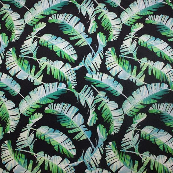 A flat sample of tossed feathers printed spandex.