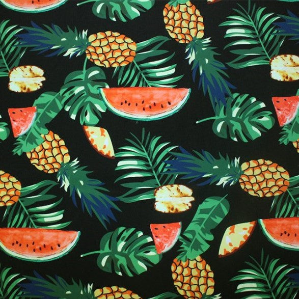 A flat sample of fruity leaves printed spandex.