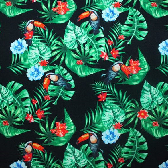 A flat sample of tropical toucans printed spandex.