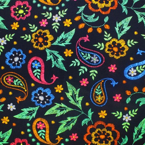 A flat sample of embroidered paisley printed spandex.
