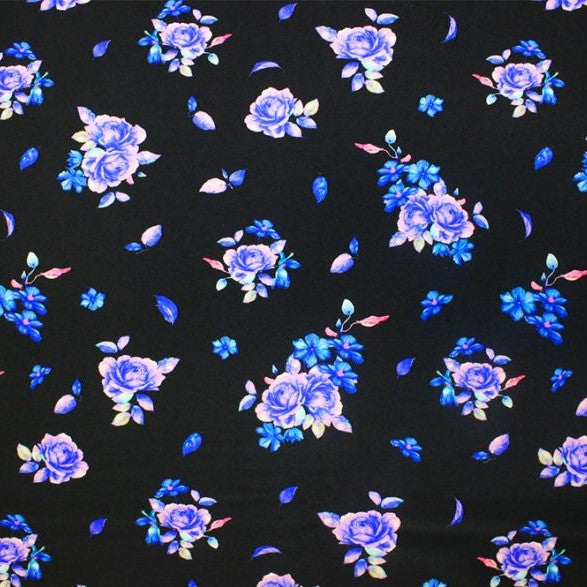 A flat sample of blue rose printed spandex.