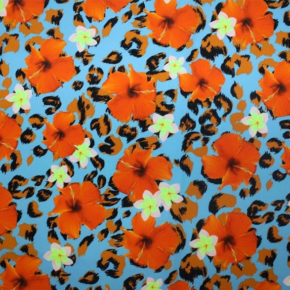A flat sample of floral cheetah printed spandex.