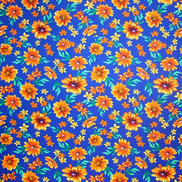 A flat sample of classic orange flowers printed spandex.