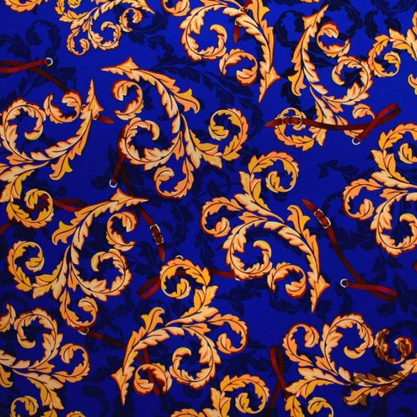 A flat sample of vintage gold paisley printed spandex.