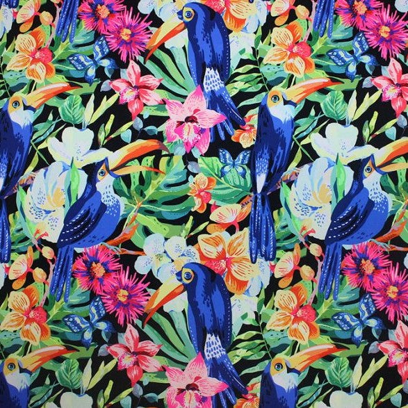 A flat sample of toucans on flowers printed spandex.