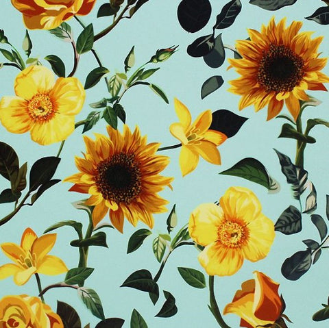 A flat sample of sun flowers printed spandex.
