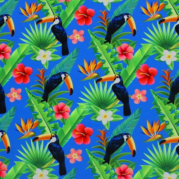 A flat sample of paradise toucans printed spandex.