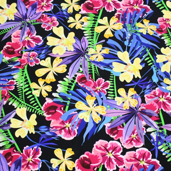 A flat sample of Hawaiian Flowers and Fronds Printed Spandex.