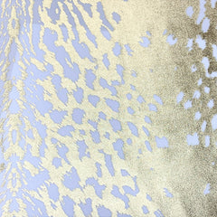 A flat sample of naga foil printed spandex in the color white/gold.