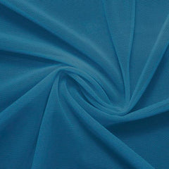 A swirled piece of nylon spandex power mesh in the color abyss.