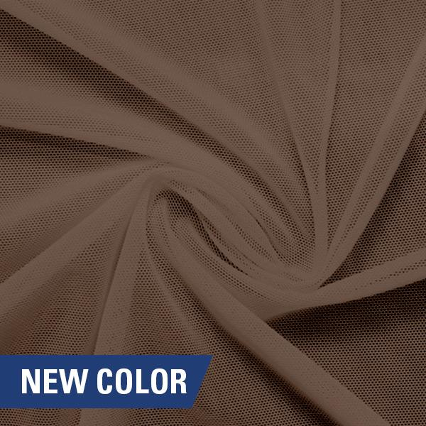 A swirled piece of nylon spandex power mesh in the color bashful.
