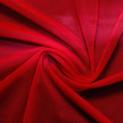 A swirled piece of nylon spandex power mesh in the color blood red.
