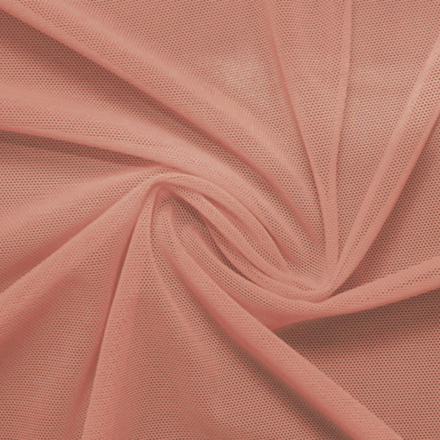 A swirled piece of nylon spandex power mesh in the color blush.