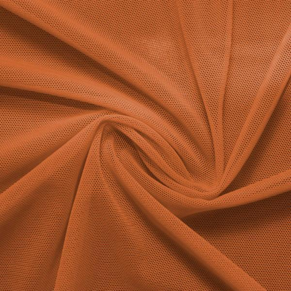 A swirled piece of nylon spandex power mesh in the color bronze.