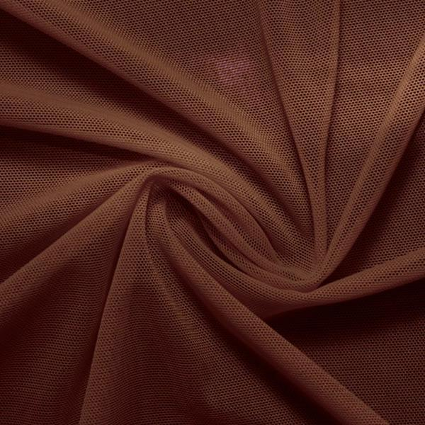 A swirled piece of nylon spandex power mesh in the color brown.