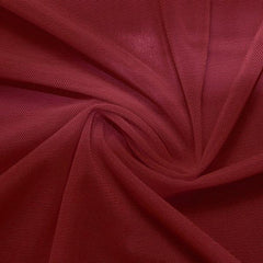 A swirled piece of nylon spandex power mesh in the color burgundy.