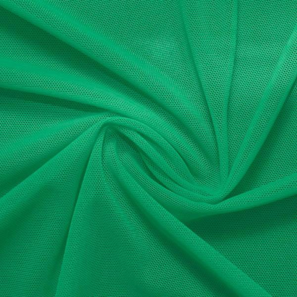 A swirled piece of nylon spandex power mesh in the color cool green.