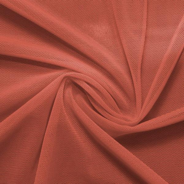 A swirled piece of nylon spandex power mesh in the color copper.